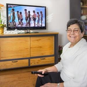 woman with tv and stand