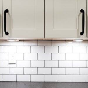 White kitchen cabinets with lighting