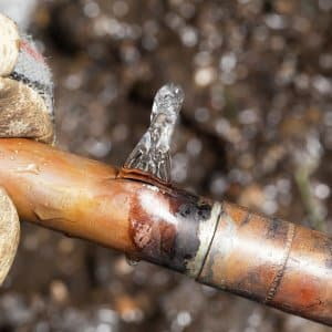 A leaking copper pipe that burst after freezing is shown. (Photo by Photo courtesy of iStock)