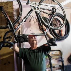 A man hanging his bike