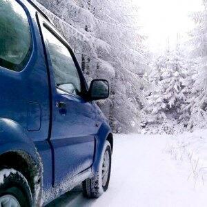 A 4x4 heads down a snowy road