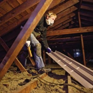 insulation professional working in attic