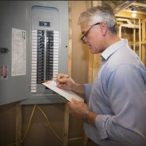 what are the signs of home electrical problems? angie's list  home inspector checks breaker box