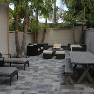 Consider mixing your paver sizes to create the illusion of a more expansive space. (Image courtesy of Charlie Gaston/Go Pavers)