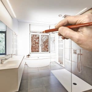 a bathroom being drawn with a hand