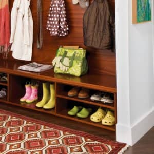 mudroom with rug and dog