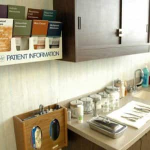 an examinging room in a doctor's office is prepped for a patient.