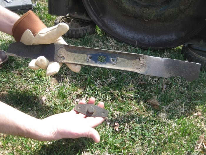 a lawn mower blade that has been removed from a lawn mower
