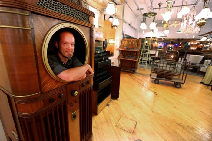 Bret Hodgert stands inside a Mills Panoram Soundie, manufactured in November 1940 (Photo by Brent Drinkut)