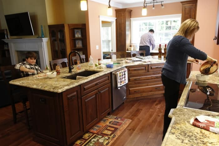 wide aisles, shorter countertops in accessible kitchen