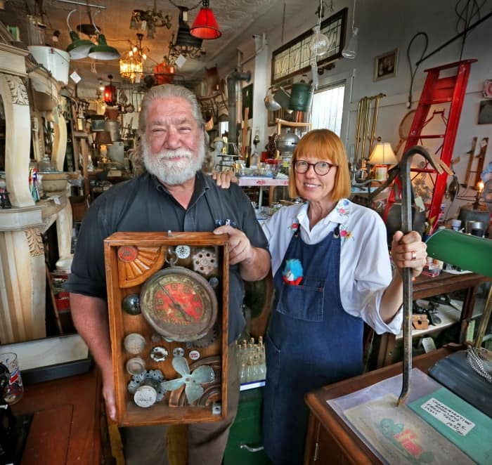 owners standing in an antique store (Photo by Frank Espich)