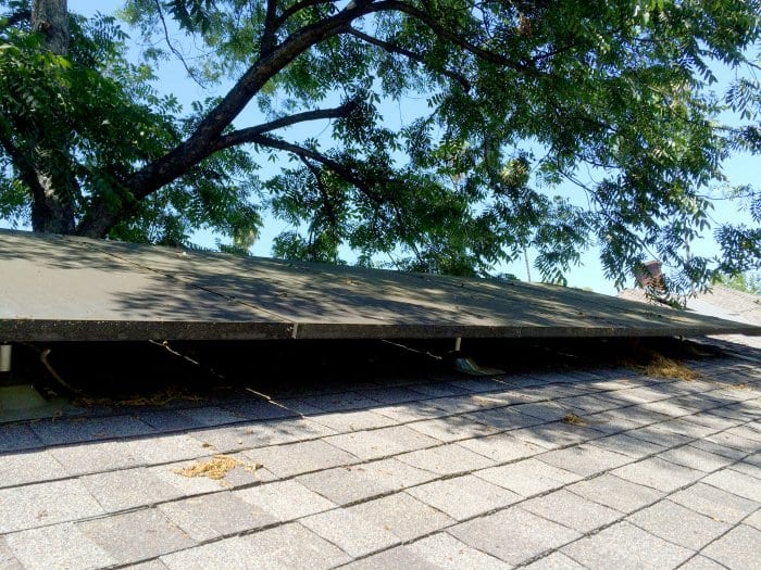 Solar roof panels positioned in partial shade.