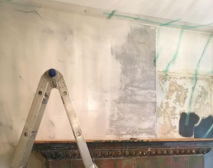 painted tile fireplace before photo