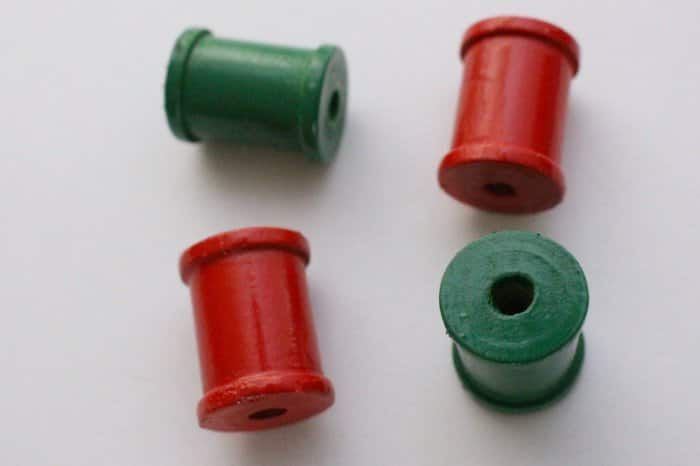 Green and red painted spools