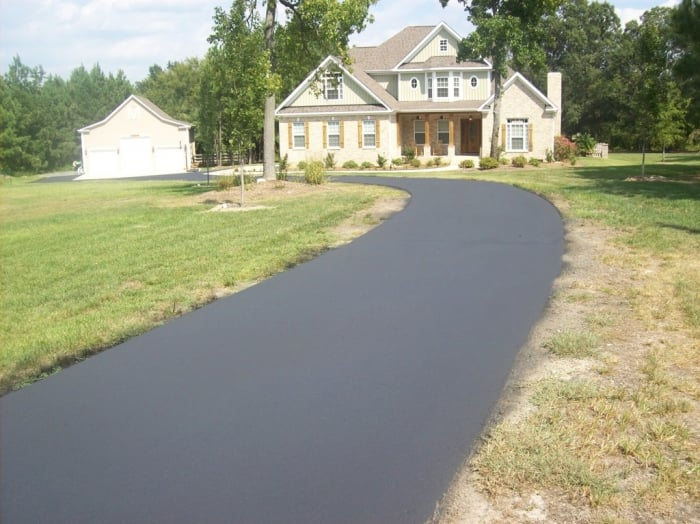 seal coated asphalt driveway in front of home