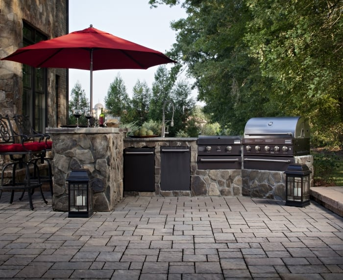 outdoor kitchen with brick pavers and stainless steel grill - How Much Does An Outdoor Kitchen Cost? Angie's List