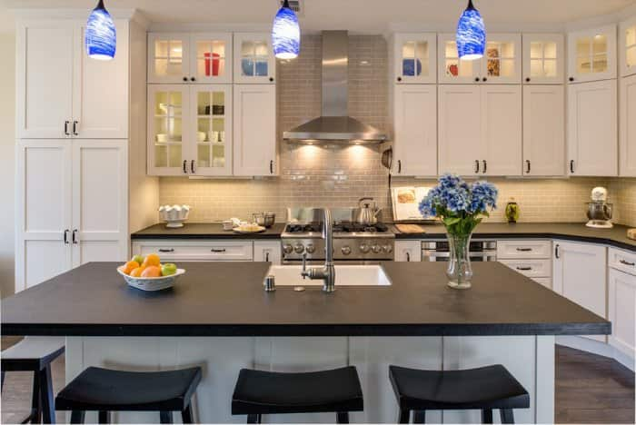 Adding some colored overhead lights and under-cabinet lighting in your kitchens brightens the room and adds color. (Photo courtesy of Joe Christenson/Remodel Works)