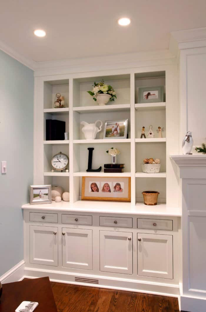 Wasted space can have custom built-ins added to create beautiful storage solutions that match your home.  (Photo courtesy of Beth Orr/Dover Home Remodelers)