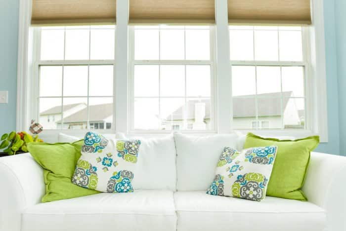 Brightly colored or uniquely patterned pillow instantly change a room and can be regularly swapped throughout the year. (Photo by Summer Galyan)