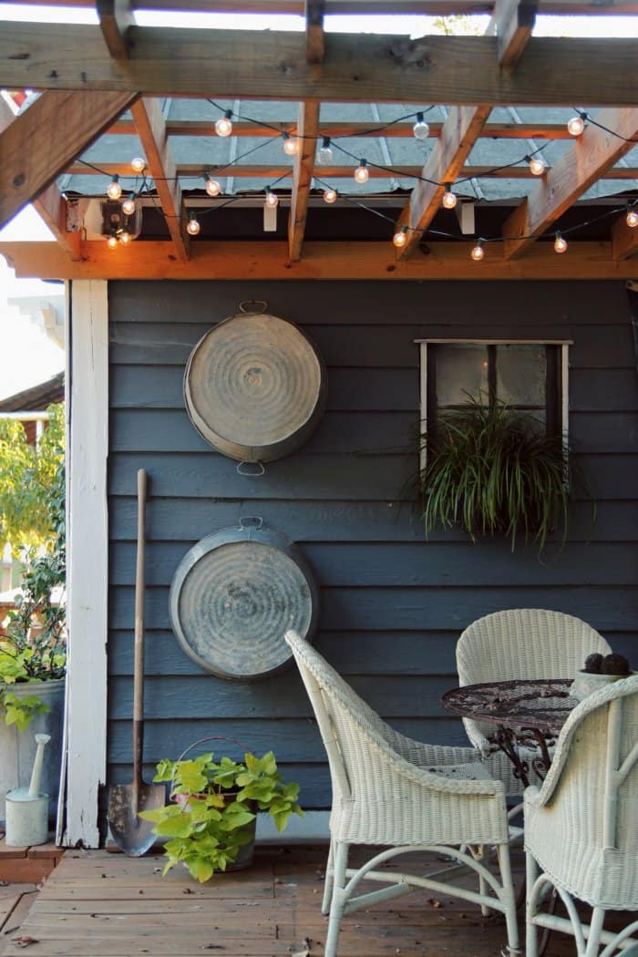 Add a porch to your garden shed for an additional outdoor space to relax or entertain guests. (Photo courtesy of Trinity Holmes at Circa '34)