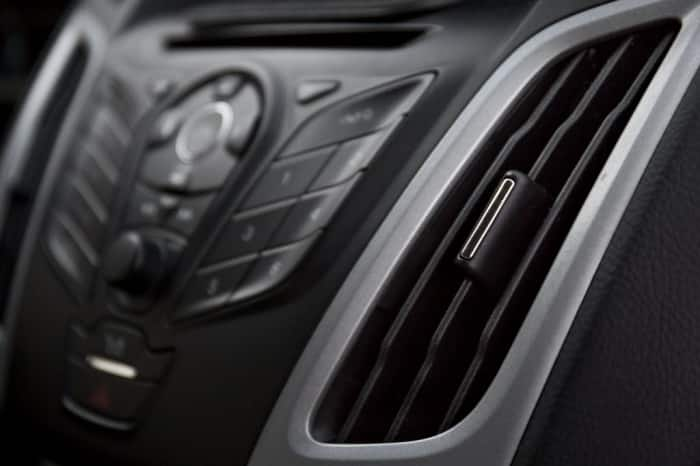 Picture of a car's A/C vents.