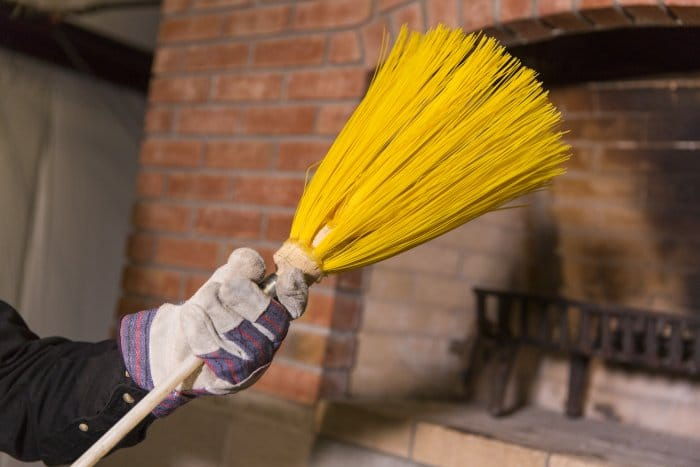 One common chimney sweep method involves using a brush attached to a cordless drill, according to the Chimney Safety Institute of America. (Photo by Eldon Lindsay)