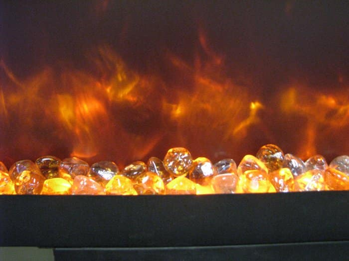 clear glass beads in electric fireplace with flames