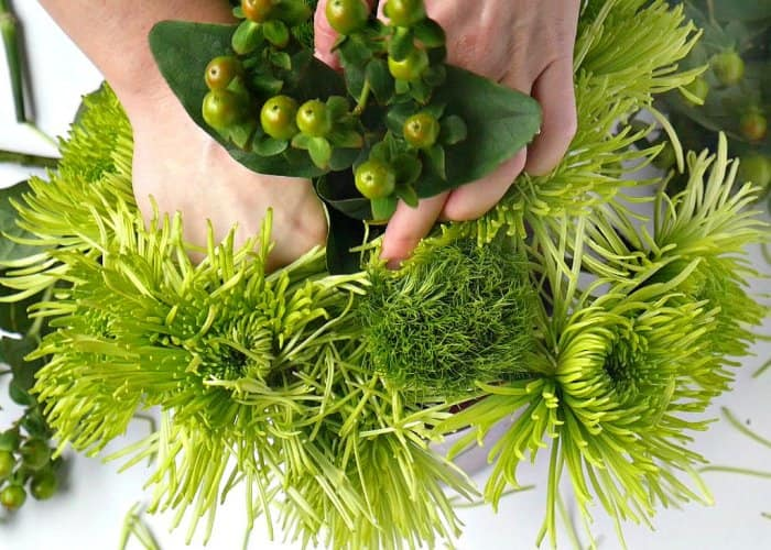 Add additional greenery to your Christmas bouquet. (Photo by Taryn Whiteaker/Design, Dining and Diapers)