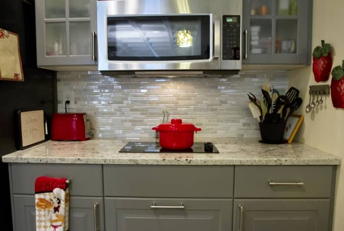 kitchen with backsplash, stovetop and microwave