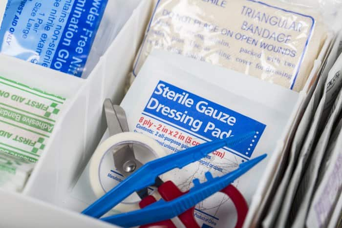 first aid kit up tweezers and gauze