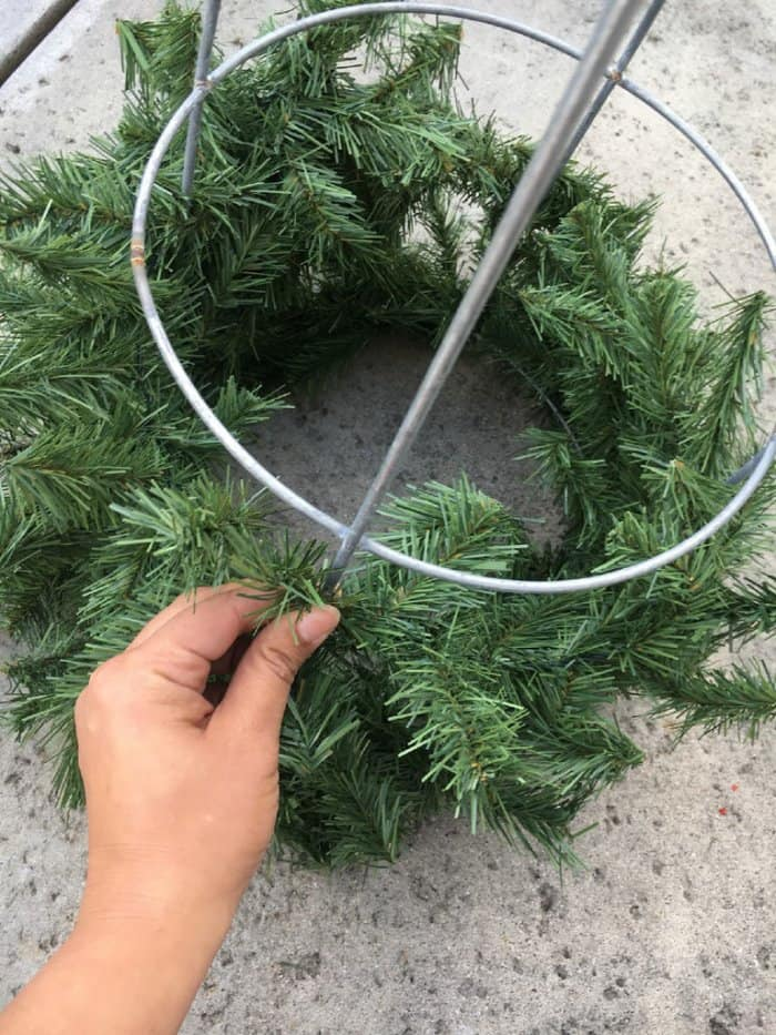 Wire garland will make sure it stays in place, but zip ties can add extra security. (Photo by Melissa Riker/The Happier Homemaker)