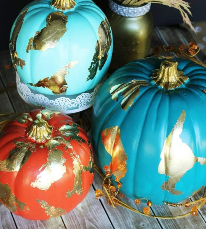 Add some gold to your painted pumpkins for a glamorous look. (Image courtesy of Positively Splendid)