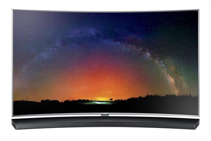 Samsung HW-J8500 sound bar set up in front of a curved HDTV.
