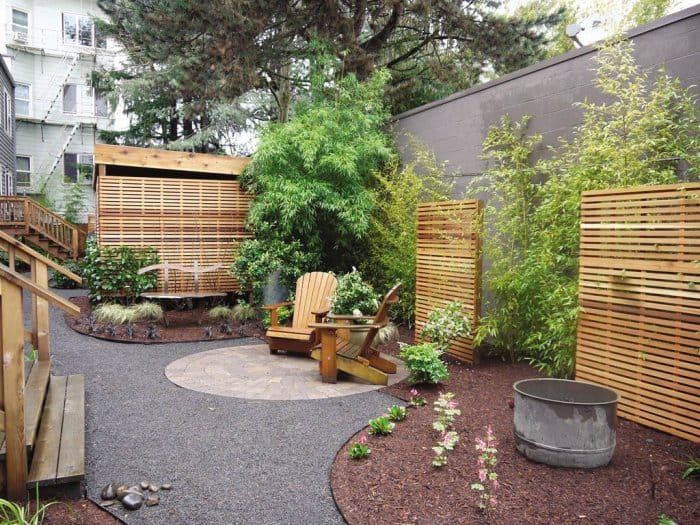 Backyard with stone, wood and plant features