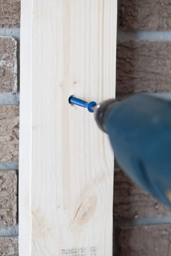 drill screwing nail into board