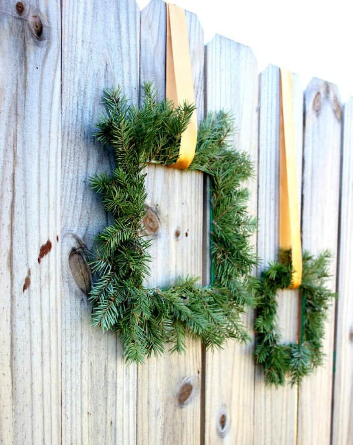 Make a fake wreath out of old paint sticks for Christmas. (Image courtesy of Oh My Creative)