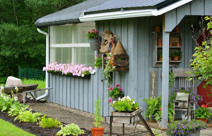 Add Flowers, Plants And Rustic Decor Around A Shed To Create A Cohesive  Look.