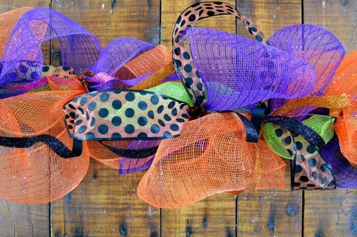 adding ribbon to DIY Halloween garland