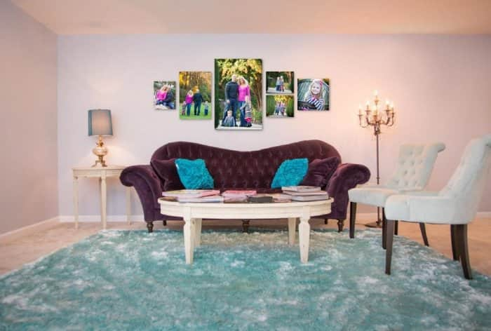 Send your family photographer photos of your rooms so that s/he can show you what your favorite family portraits will look like hanging over your furniture in various frames, groupings, and sizes. (Photo by Irene Abdou)