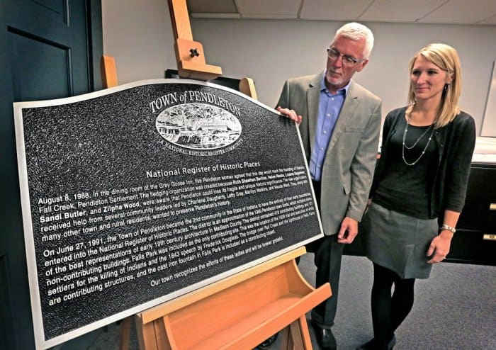 Pendleton, Indiana Town Manager Tim McClintick and Planning/Zoning coordinator Rachel Christensen and a historic marker.