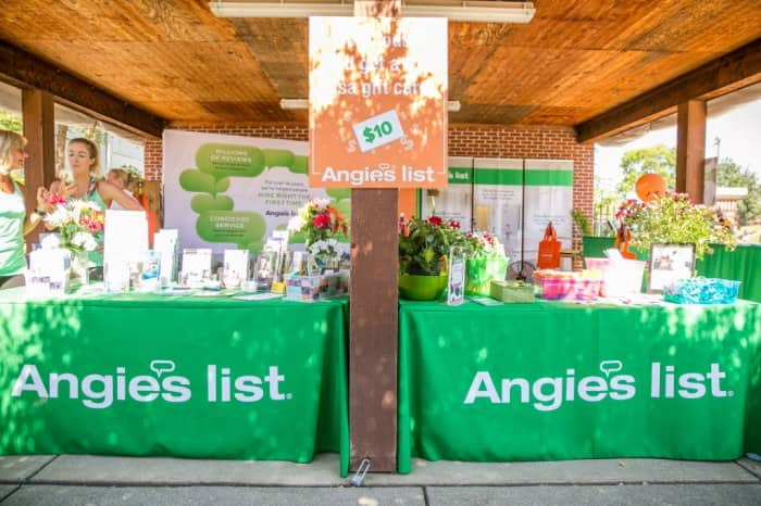 Two green Angie's List tables with pamplets at the Indiana State fair