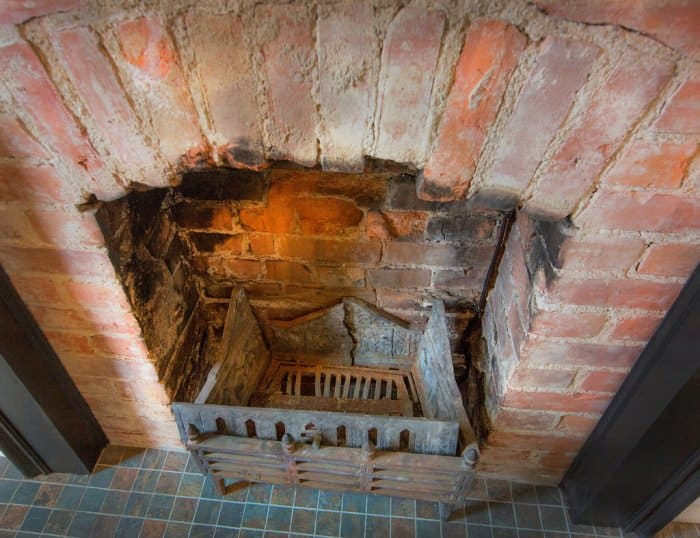 An old brick fireplace in a Herron-Morton home in Indianapolis