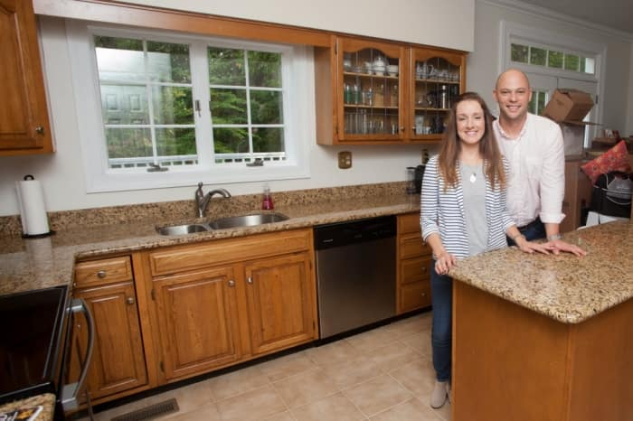 couple in kitchen with outdated look