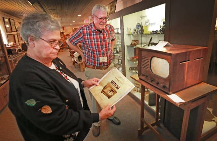 Pendleton Historical Society volunteers Barbara and Rex Mercer with a 1948 TV set.