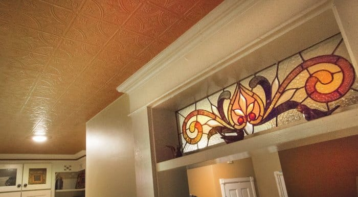 A tin textured ceiling and stained glass in a Pendleton, Indiana home.