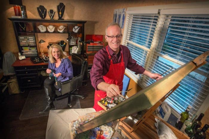 Randy Sorrell painting and Kimberly Sorrell making jewelry in their dining space