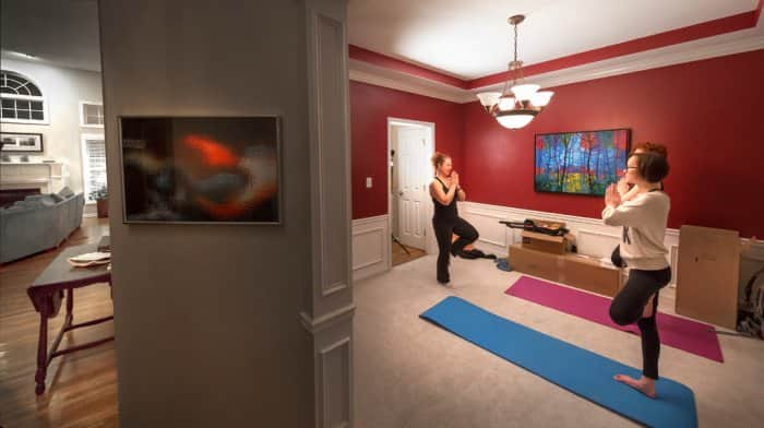 Women doing yoga in dining room space