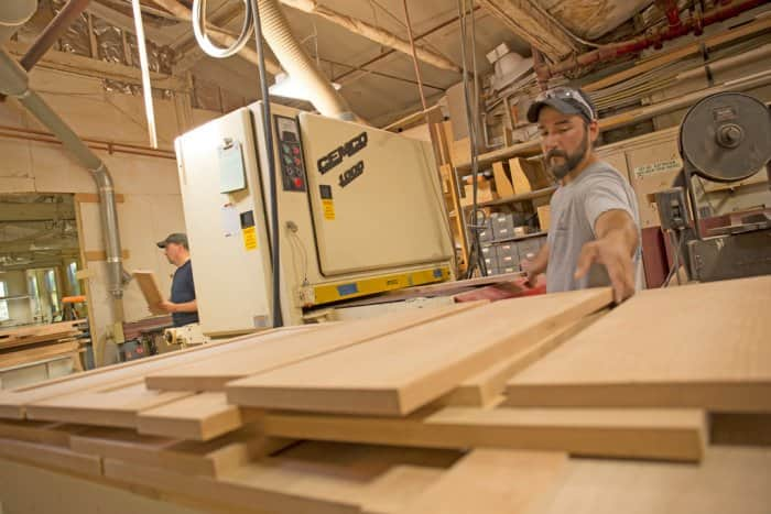 Taggart Construction employees work with lumber at their Maine shop