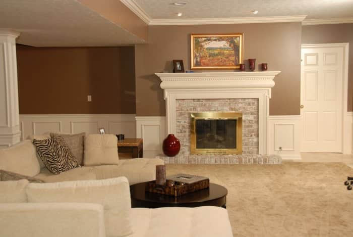 basement living room with fireplace