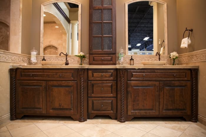 Dark stained bathroom sink vanity with linen cabinet Bathroom Sink Vanity and Cabinet Options  Angie s List